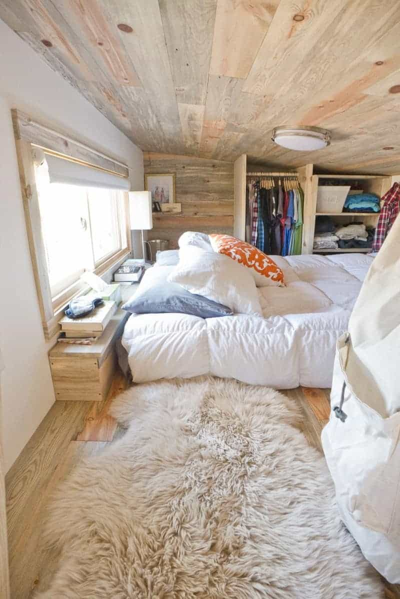 Large loft sleeping area photo with double bed and small closet.