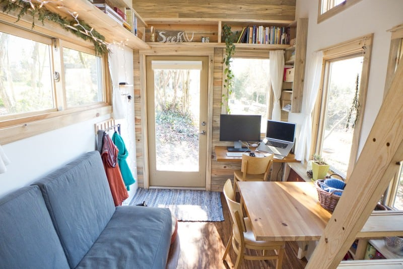 Interior photo of a small office and living room in a tiny house.