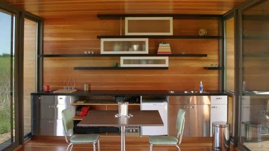 Here's a kitchen in a prefab tiny house. The kitchen has everything you need although the fridge is small... the space warrants a larger fridge. All the windows and open concept space is fantastic though.