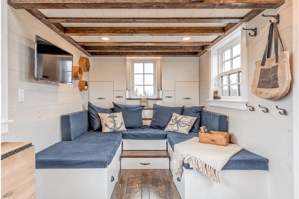 U-shaped sectional sofa in tiny house living room with TV