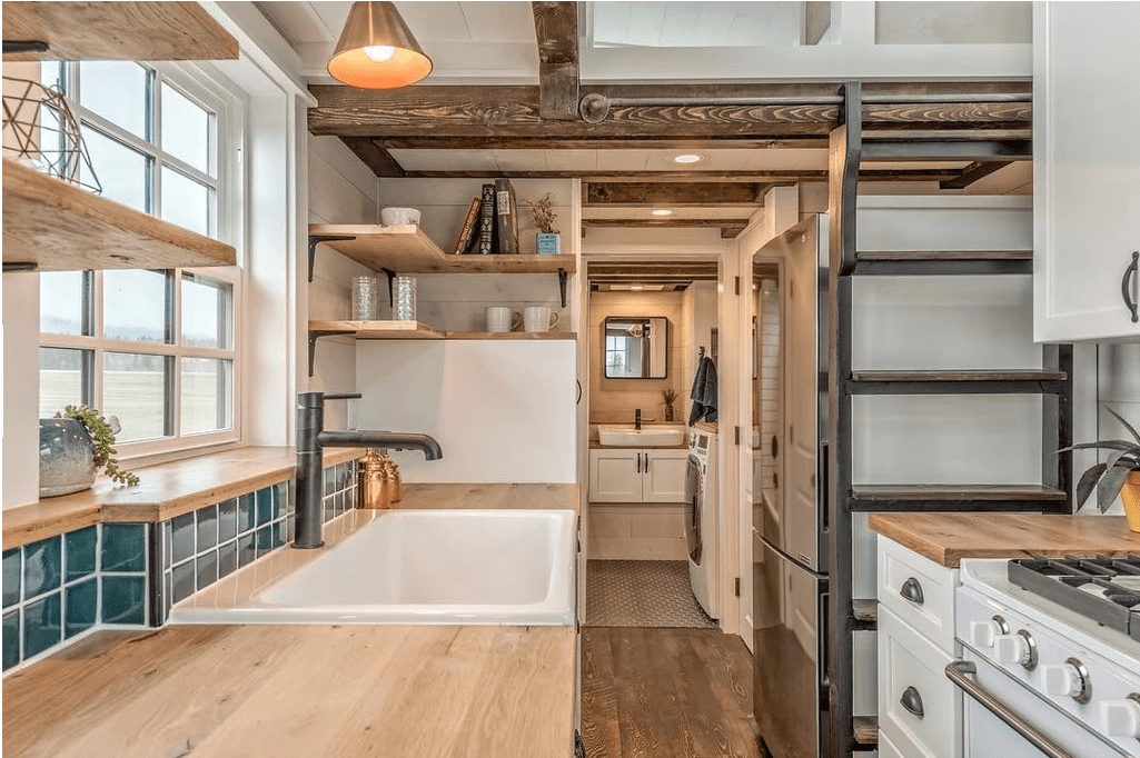The kitchen offers plenty of counter space as well as a large white sink.