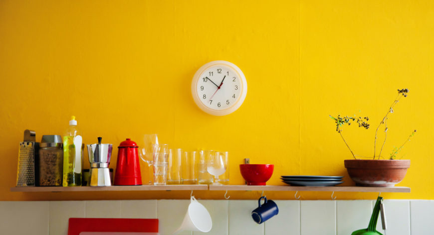 Yellow kitchen wall with clock