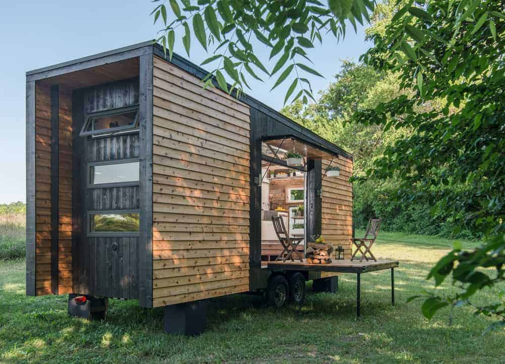 Modern-style tiny house with drop-down deck area.