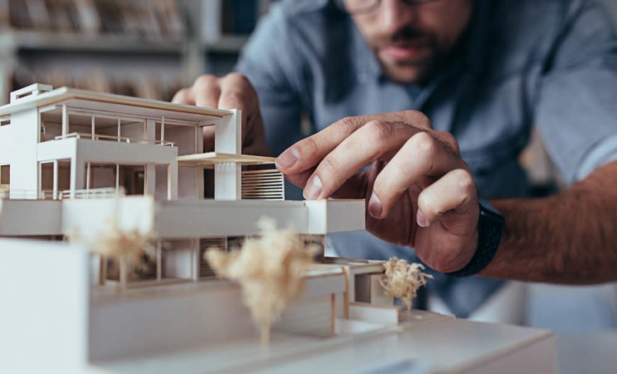 architect working on model building