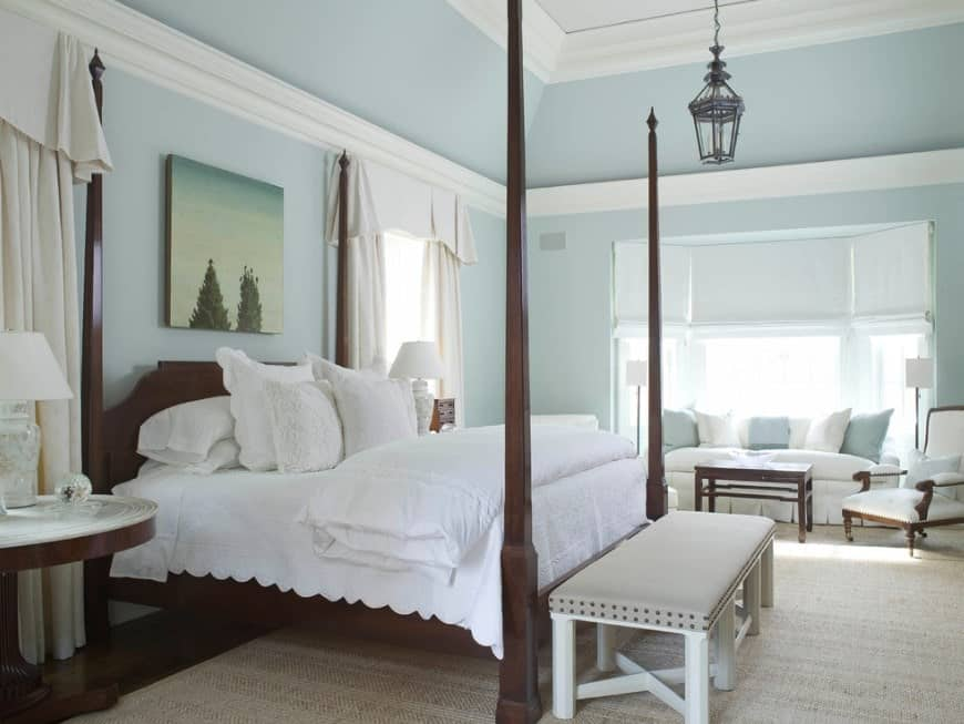 Surrounded by light blue walls and ceiling, this primary bedroom looks so graceful.
