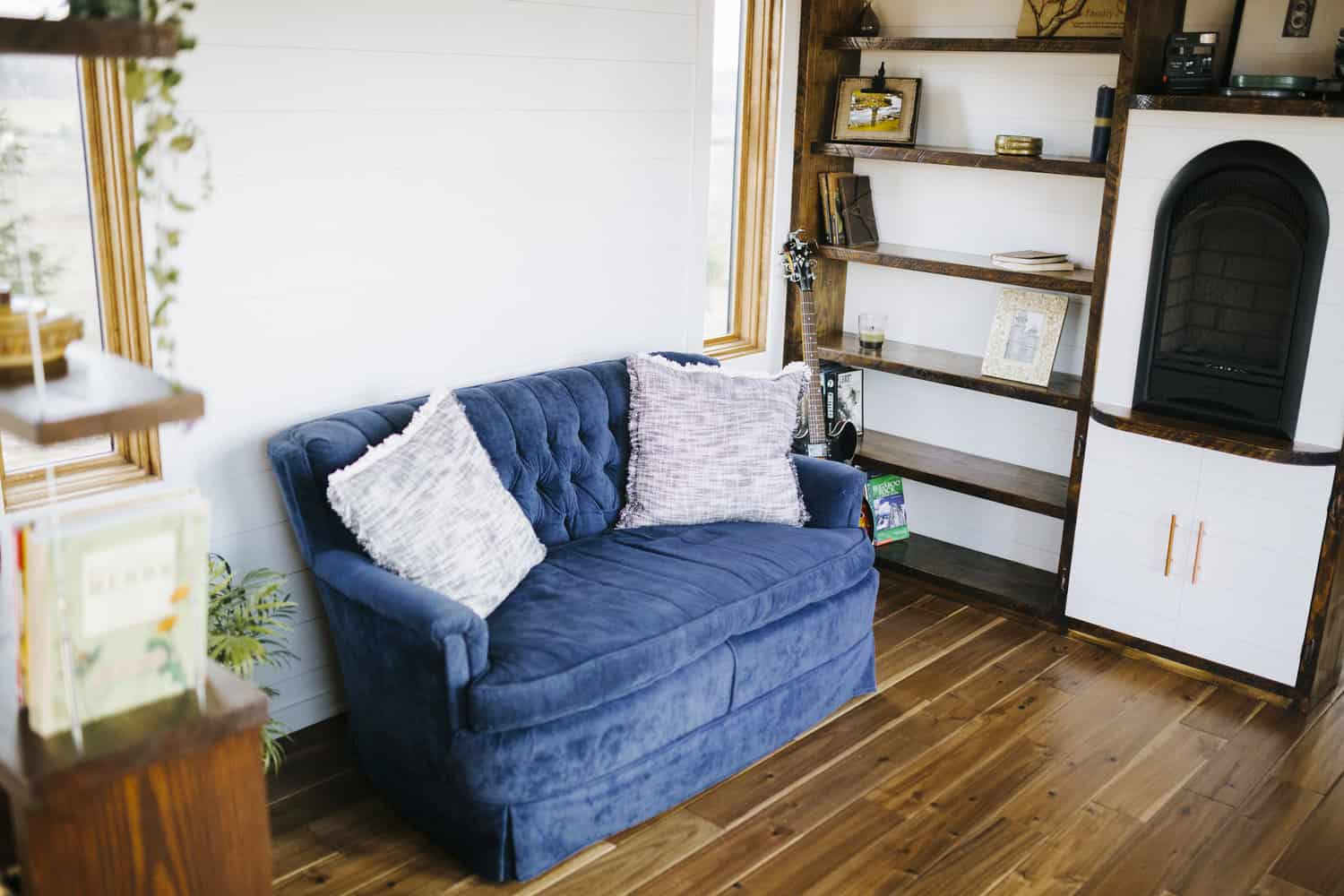 blue sofa in tiny house living room