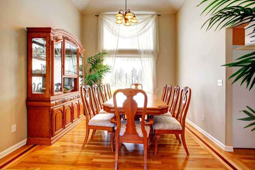 This home boasts an elegant set of dining table and chairs set on the home's hardwood floors.
