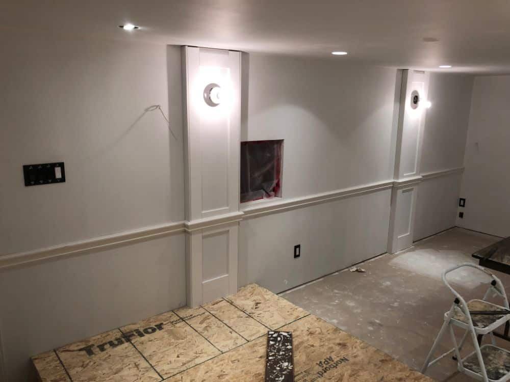 A large square is cut into the wall which is where the audio-visual control panel will go.
