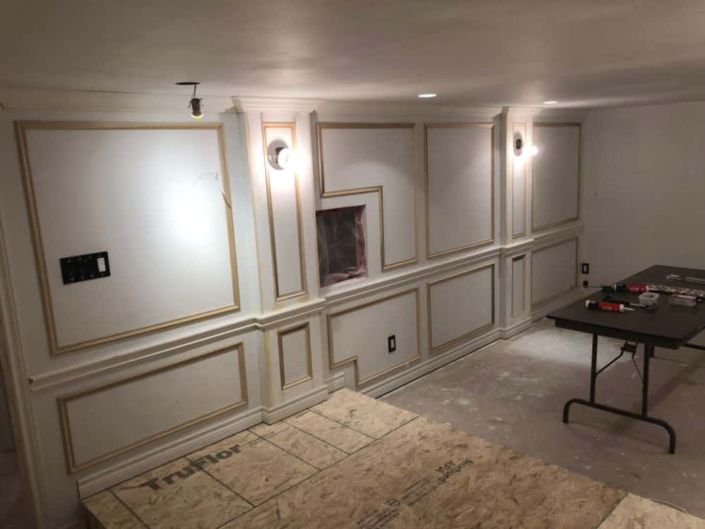 One aspect of this media room that makes it awesome is the custom wall paneling to give it a vintage cinema look. You can see it in progress here.