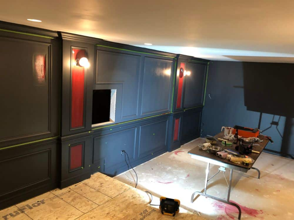 The home theater is starting to shape up nicely at this point. The red accent on the wall columns is applied which will match the deep red carpeting.