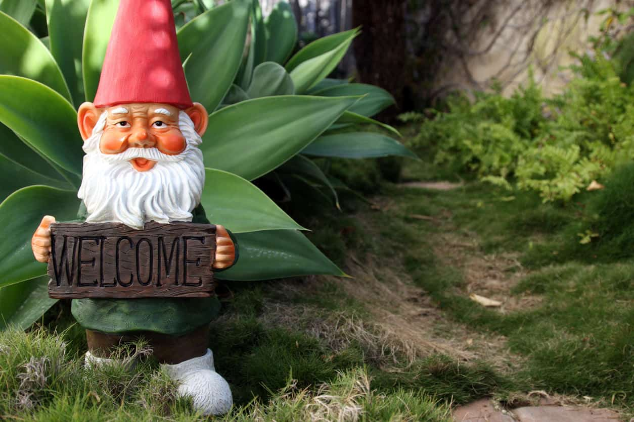 Garden gnome with welcome sign.