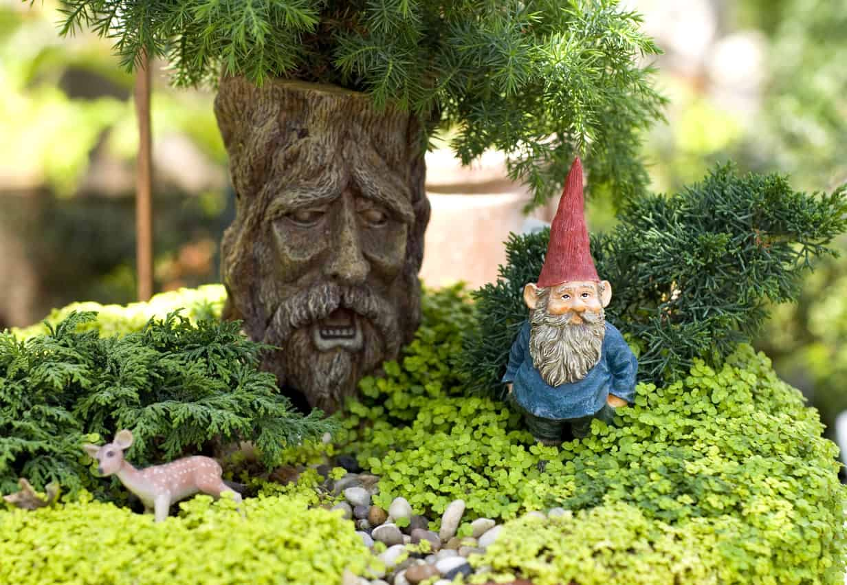Miniature container garden pot with small trees, gnome and miniature deer.