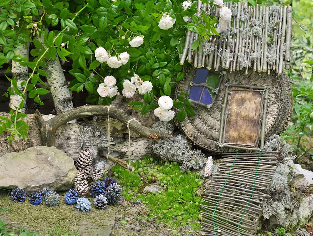 Fairy garden made with lots of sticks tied together.