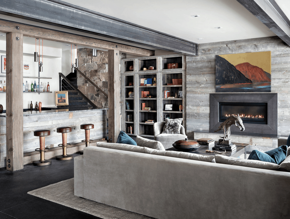 A modish living space and a rustic bar area set in the home's finished basement.