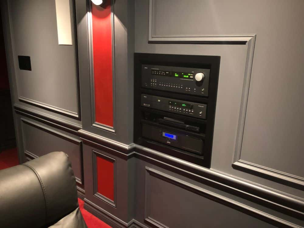 Close up of the audio-visual control panel that controls the sound and projector. It's professionally mounted into the wall and makes it super easy to run this theater.