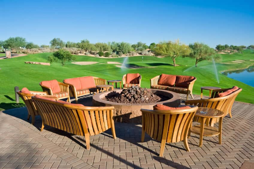 Here's an example of ample seating using a variety of matching patio furniture that includes chairs, loveseats and sofas.