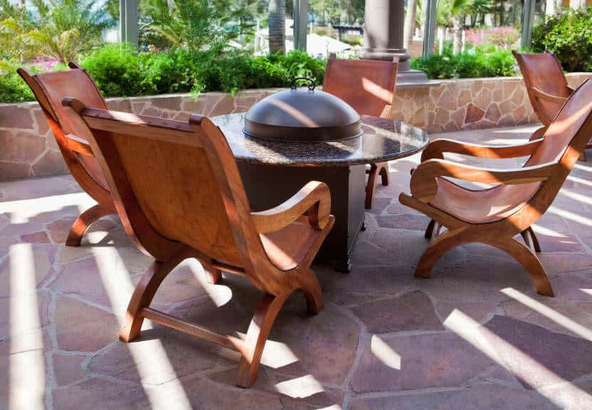 Here are some lovely and comfortable wood patio chairs around a fire pit table. This is a good arrangement for a smaller patio.