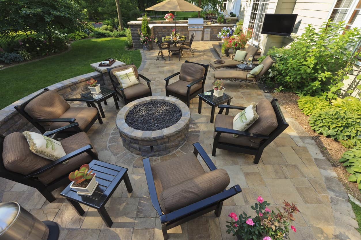 Another example of multiple patio chairs with three small side tables around a large patio fire pit. The multiple side tables are a nice touch - everyone has a place to put their drinks, devices, etc.