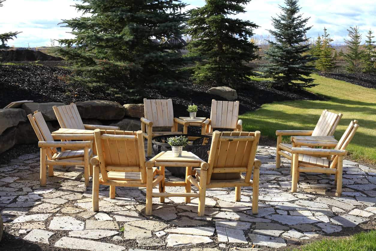 Here's an example of rustic seating around a patio fire pit - these are rustic log chairs that look great and are reasonably comfortable.