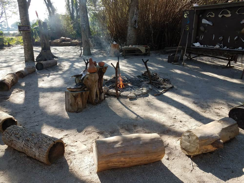 Or lay large logs on the side for log benches to be used around a fire.