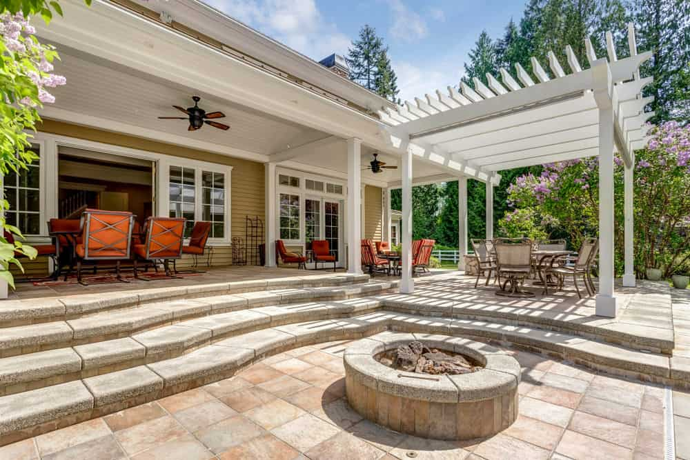 If you have a multi-level patio you can use the stairs as a place to sit around a fire pit.