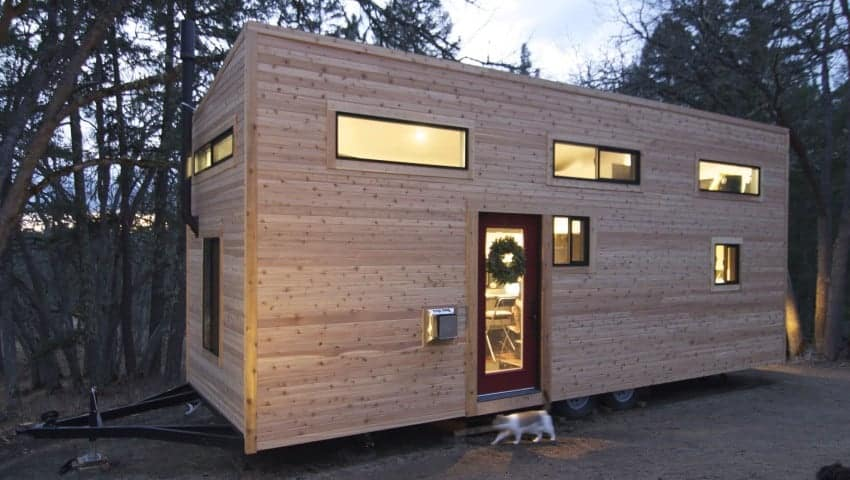 Tall tiny house exterior photo with wood siding.