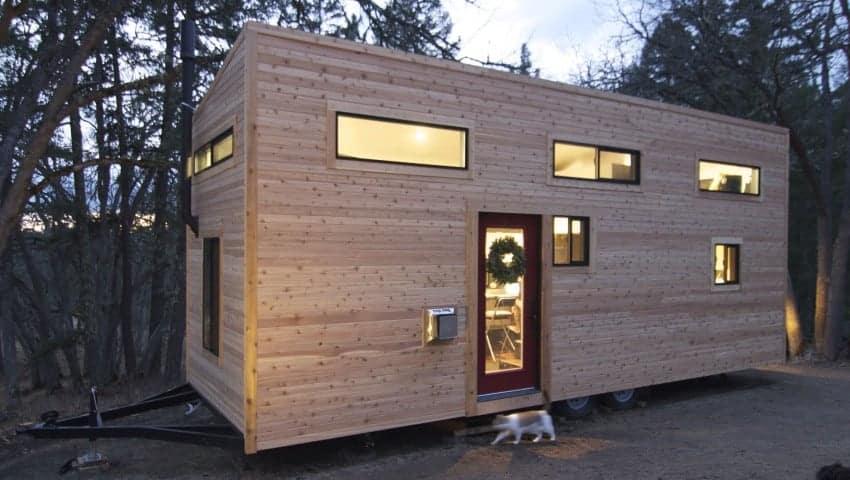 Tall tiny house exterior photo with wood siding.