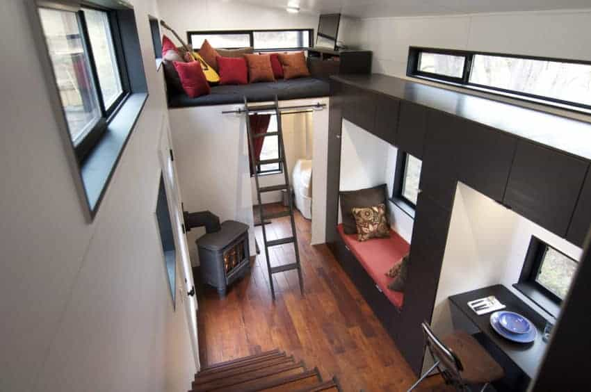 Photo of the loft sleeping area and reading nook inside tiny house.