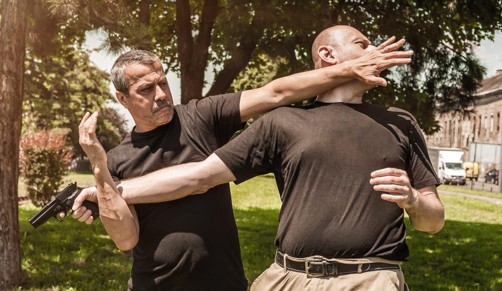 man disarms man with gun