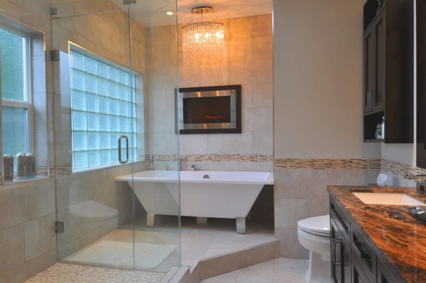 Primary bathroom featuring a walk-in shower, a freestanding tub situated on the corner and an elegant sink countertop.