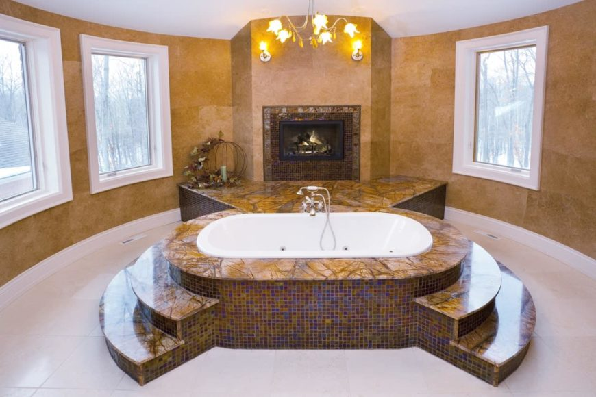 A close up look at this primary bathroom's classy drop-in tub surrounded by beautiful walls and is lighted by a fabulous ceiling lighting.