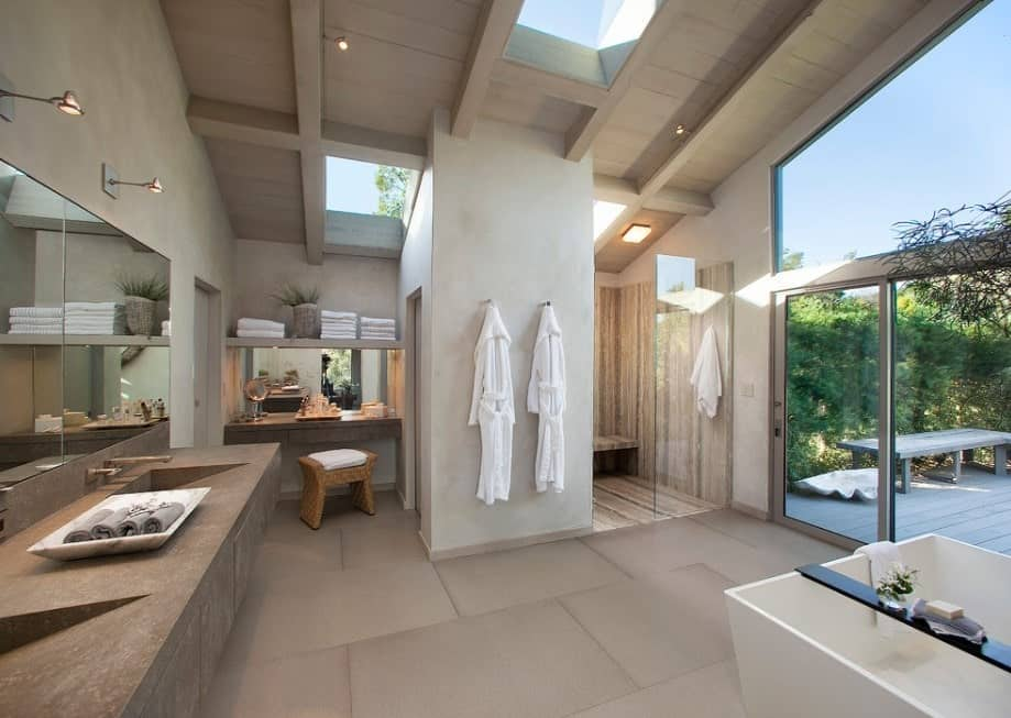 A large primary bathroom featuring a stunning sink area along with a freestanding tub and walk-in shower area.