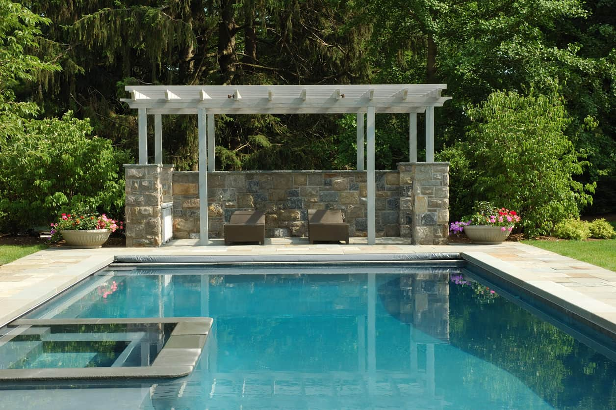 A Luxurious Custom Made Swimming Pool With Pergola On The Side Offering Of Sitting Lounges