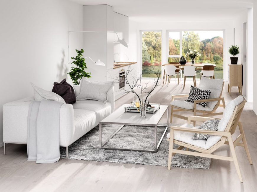 A Scandinavian-Style great room with white sofa set and a gray rug, along with a small rectangular dining table set near the glass walls.