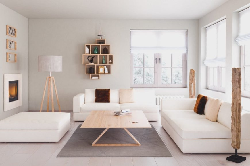 Scandinavian-Style living room featuring a white sofa set and a gray rug covering the tiles flooring. The room also has light gray walls and ceiling.