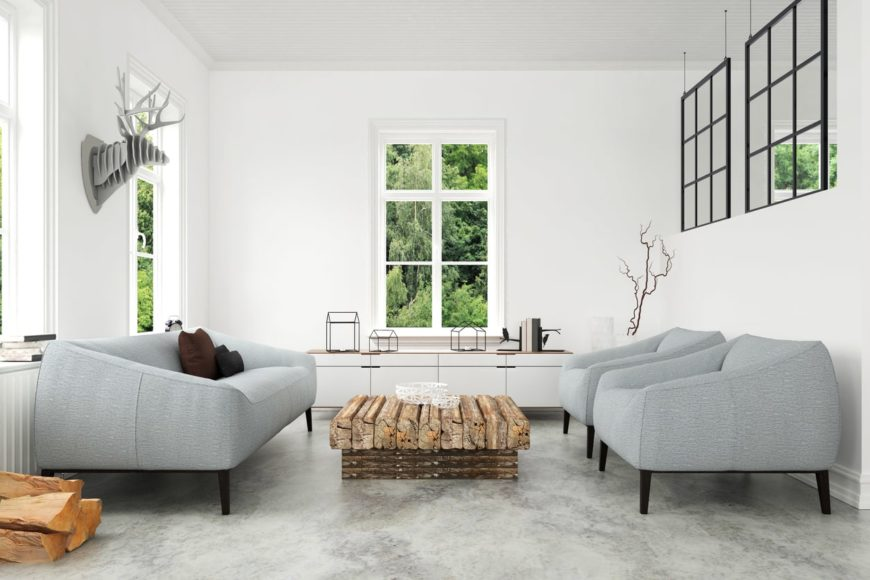 Scandinavian-Style living room featuring gray seats and stylish flooring, along with white walls and ceiling.