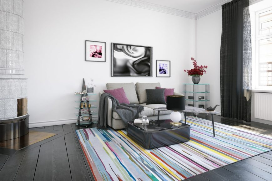 This Scandinavian-Style living room boats dark hardwood floors topped by a colorful area rug. The wall decors are absolutely eye-catching as well.