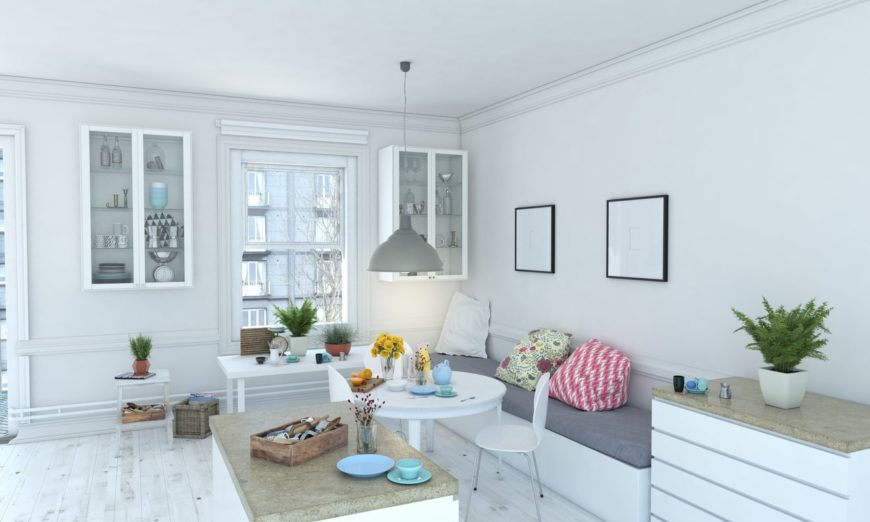 White Scandinavian-Style living room featuring a bench seating, along with a small round table set lighted by a pendant lighting. The room also has built-in shelving.