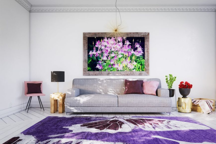Scandinavian-Style living room featuring hardwood floors topped by a large violet rug that looks perfect together with the rustic framed violet flowers wall decor.