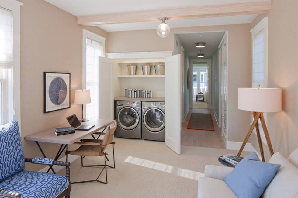 Another great space-saver closet-type laundry space. The room also features a nice sitting area and a multi-purpose desk.
