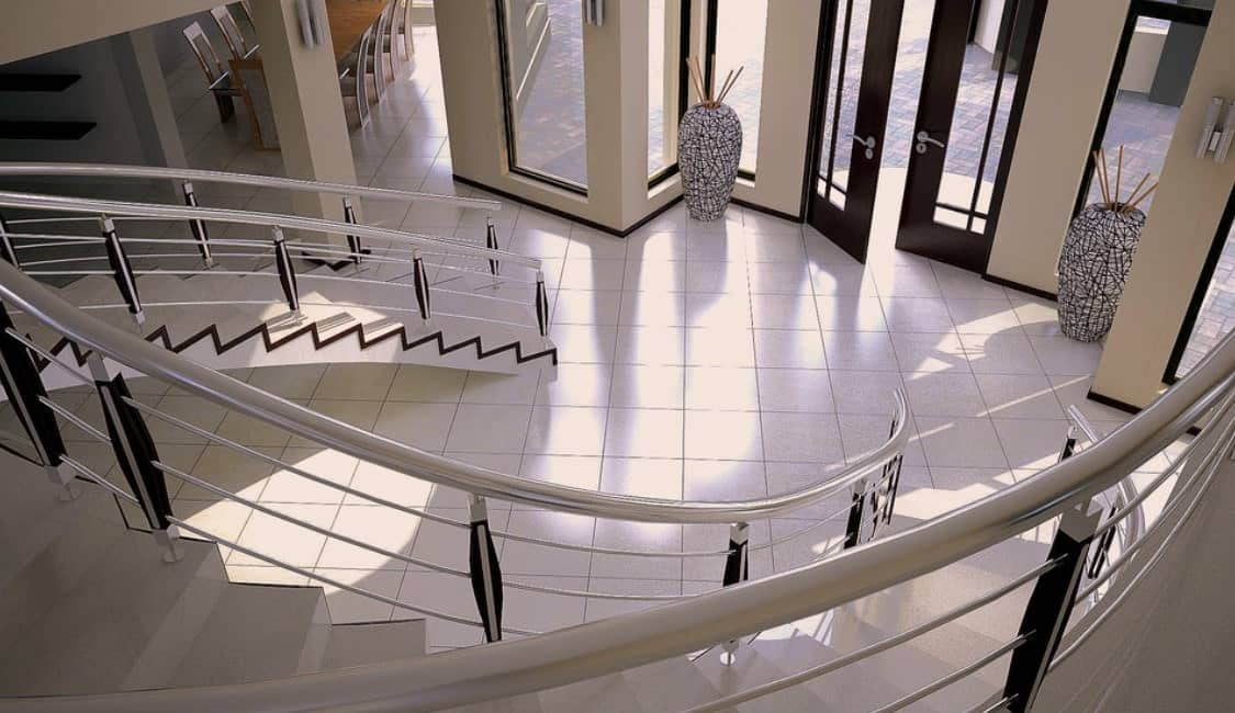 A double staircase with stylish flooring and railings combination.