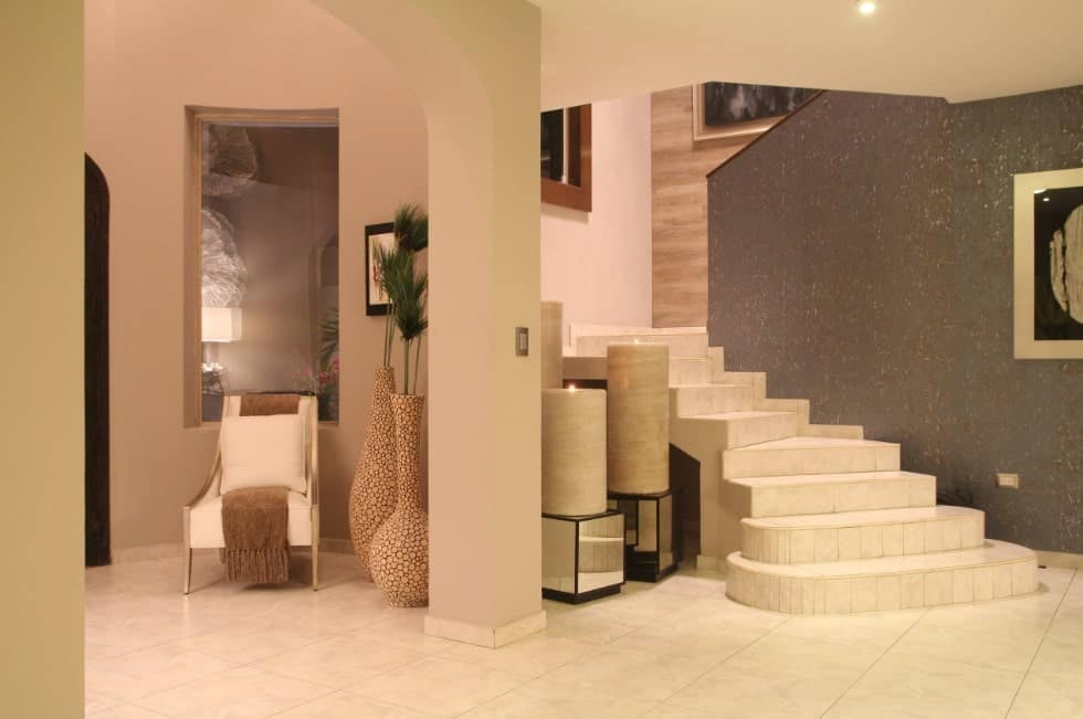 A glamorous home entry featuring a staircase with a charming built.