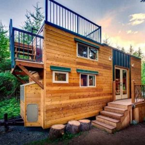 Custom designed tiny house with balcony and roof-top deck.