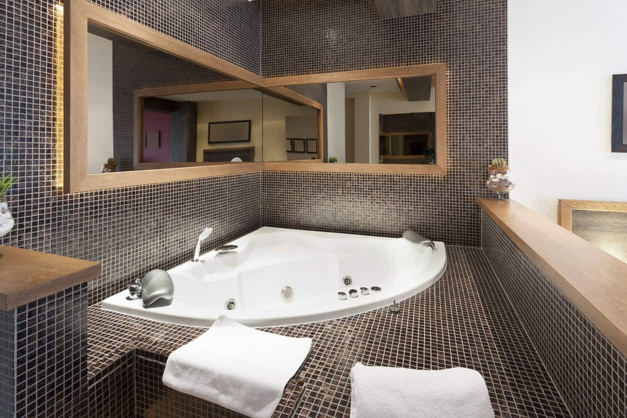 This corner bathtub gives off some real disco-ball vibes, courtesy of the metallic tiles that surround it.