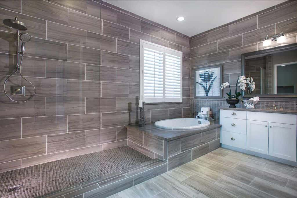 While most corner bathtubs are closed off from the shower, this style isn't. the modern tiling goes seamlessly from tub to shower, too.