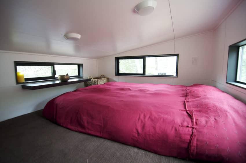 Bedroom loft area in tiny house