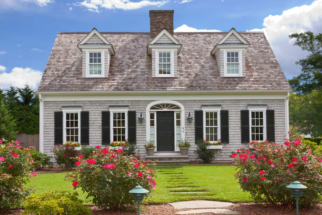 Hyannis, MA, USA: New England Home with gray shingle exterior and black window shutters in Hyannis, Cape Cod, Massachusetts, USA.