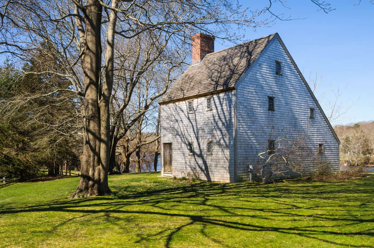 Built by Reverend John Smith c. 1675, this saltbox style home in Sandwich, on the shore of Shawme pond, is believed to be the oldest house on Cape Cod.