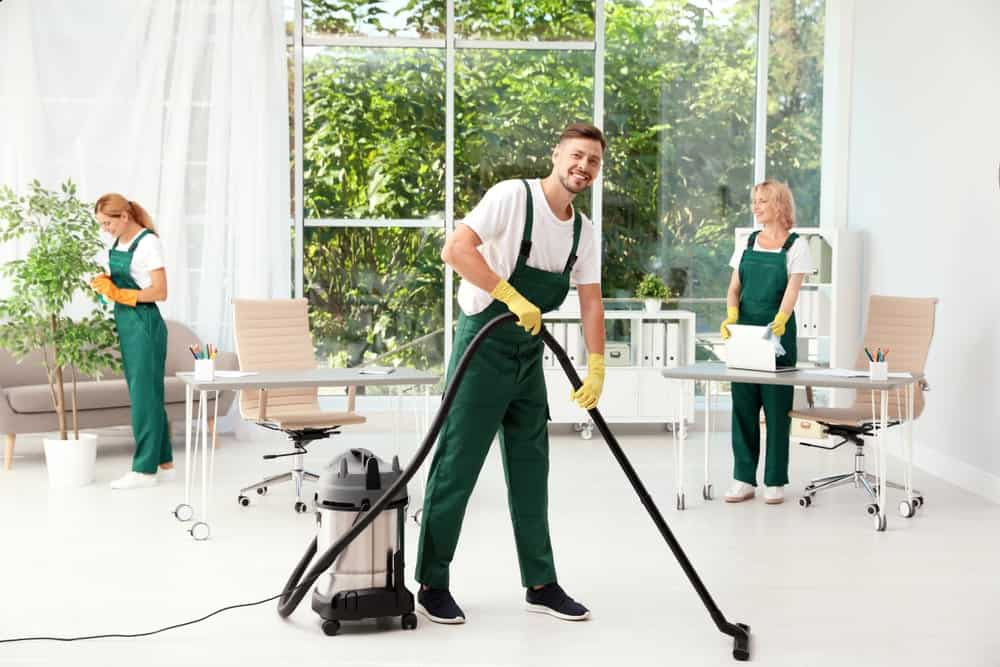 Janitors Using a Commercial Steam Cleaner