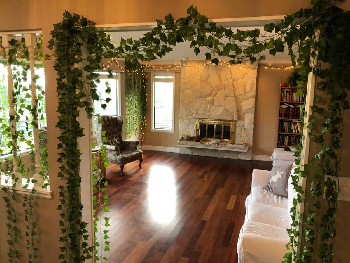 Cleared out living room for house party with wall vines and lights